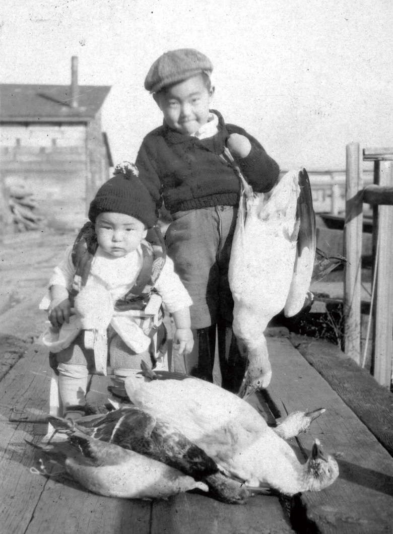 Children of a salmon collector/deliverer, the Takasaki family